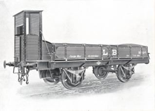 vagon de bordes bajos con garita, fondo CAF de Beasain